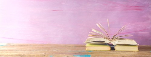 Open Book on Pink Background.jpg
