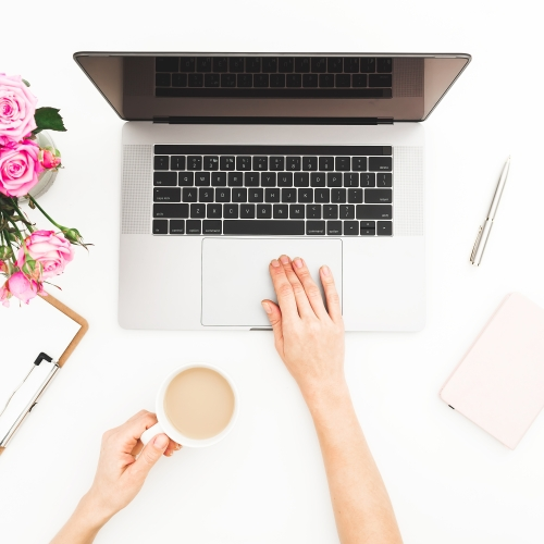 laptop with roses and cofee